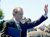Washington, D.C. - May 29, 2004 -- Former United States Senator Bob Dole (Republican of Kansas) waves to the crowd before he made remarks at the dedication of the World War Two Memorial in Washington, D.C. on May 29, 2004.  Dole was instrumental in getting the funding and approval for the monument..Credit: Ron Sachs / CNP