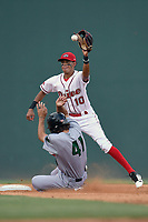 Shortstop Ricardo Cubillan (10) of the Greenville Drive takes a late throw from home as Nick Hill (41) of the Augusta GreenJackets steals second base in a game on Thursday, May 17, 2018, at Fluor Field at the West End in Greenville, South Carolina. Augusta won, 2-1. (Tom Priddy/Four Seam Images)
