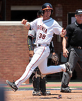 Virginia outfielder Mike Papi (38) crosses home plate in the second inning of an NCAA college baseball tournament super regional game against Maryland in Charlottesville, Va., Saturday, June 7, 2014. Maryland defeated Virginia 5-4. (AP Photo/Andrew Shurtleff)