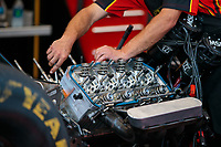 Sep 15, 2018; Mohnton, PA, USA; Detailed view as a crew member works on the engine of NHRA top fuel driver Doug Kalitta during qualifying for the Dodge Nationals at Maple Grove Raceway. Mandatory Credit: Mark J. Rebilas-USA TODAY Sports