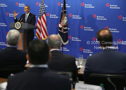 United States President Barack Obama addresses members of the Business Roundtable September 18, 2013 at the Business Roundtable Headquarters in Washington, DC. Obama spoke on various topics including the national debt ceiling and immigration reform, and then answered questions from the members after his address. <br /> Credit: Alex Wong / Pool via CNP