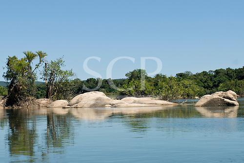 Mato Grosso State, Brazil. Xingu River. Rounded rocks in the river.