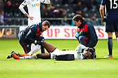 17th March 2018, Liberty Stadium, Swansea, Wales; FA Cup football, quarter-final, Swansea City versus Tottenham Hotspur; Tammy Abraham of Swansea City receives treatment for an injury to his right knee in the 2nd half