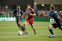 Chicago Fire midfielder Sebastian Grazzini (10) dribbles in between Philadelphia Union midfielder Gabriel Gomez (6) and defender Chris Albright (3).  The Chicago Fire defeated the Philadelphia Union 1-0 at Toyota Park in Bridgeview, IL on March 24, 2012.