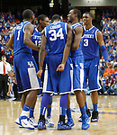 Teammates gather together near the end of the championship of the 2011 SEC Men's Basketball Tournament between Kentucky and Florida, played at the Georgia Dome, Sunday, March 13, 2011.  Kentucky won 70-54.  Photo by Latara Appleby | Staff