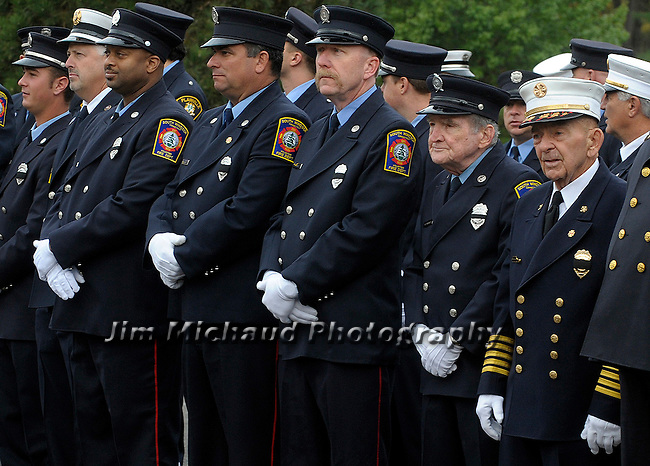South Windsor firefighters, including former Chief William Lanning, right, stand in formation prior to the funeral for  for Hartford firefighter Kevin Bell, Monday, Oct 13, 2014, at the First Cathedral, in Bloomfield,  Bell was killed in a house fire last week in Hartford. (Jim Michaud / Journal Inquirer)