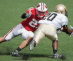 September 19, 2009: Wisconsin Badgers defensive back Chris Maragos (21) tackles Wofford Terriers running back Mike Rucker (20) during an NCAA football game at Camp Randall Stadium on September 19, 2009 in Madison, Wisconsin. The Badgers won 44-14. (Photo by David Stluka)