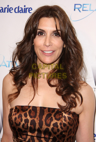 JO CHAMPA .Relativity Weinstein Company 68th Annual Golden Globe Awards After Party Presented by Marie Claire held at the Beverly Hilton, Beverly Hills, California, USA..January 16th, 2011.headshot portrait black dress brown leopard print strapless  .CAP/ADM/TB.©Tommaso Boddi/AdMedia/Capital Pictures.