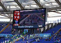 Calcio, Serie A: Roma vs Lazio. Roma, stadio Olimpico, 8 novembre 2015.<br /> Valencia's Motorcycle Grand Prix is broadcasted on scoreboards prior to the start of the Italian Serie A football match between Roma and Lazio at Rome's Olympic stadium, 8 November 2015.<br /> UPDATE IMAGES PRESS/Isabella Bonotto