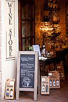 Grotta del Brunello wine shop in Costa di Piazza Garibaldi in old hill town of Montalcino, Val D'Orcia, Tuscany, Italy