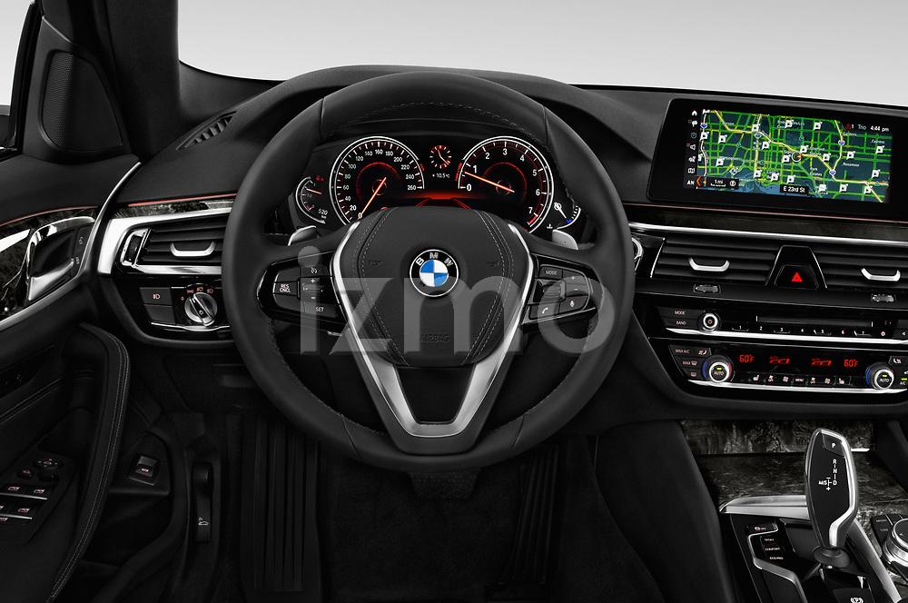 Car pictures of steering wheel view of a 2018 BMW 5 Series Sport 4 Door Sedan