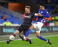 4th February 2020; Cardiff City Stadium, Cardiff, Glamorgan, Wales; English FA Cup Football, Cardiff City versus Reading; Michael Morrison of Reading plays the back pass as he is pressured by Robert Glatzel of Cardiff City