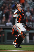 SAN FRANCISCO, CA - MAY 21:  Buster Posey #28 of the San Francisco Giants chases a pop up against the Atlanta Braves during the game at Oracle Park on Tuesday, May 21, 2019 in San Francisco, California. (Photo by Brad Mangin)