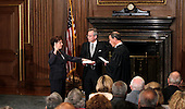Elena Kagan is sworn in as the Supreme Court's newest member as Chief Justice John Roberts, right, administers the judicial oath at the Supreme Court Building in Washington, Saturday, August 7, 2010. The Bible is held by Jeffrey Minear, center, counselor to the chief justice. Kagan, 50, who replaces retired Justice John Paul Stevens, becomes the fourth woman to sit on the high court and is the first Supreme Court justice in nearly four decades with no previous experience as a judge. .Mandatory Credit: J. Scott Applewhite - Pool via CNP
