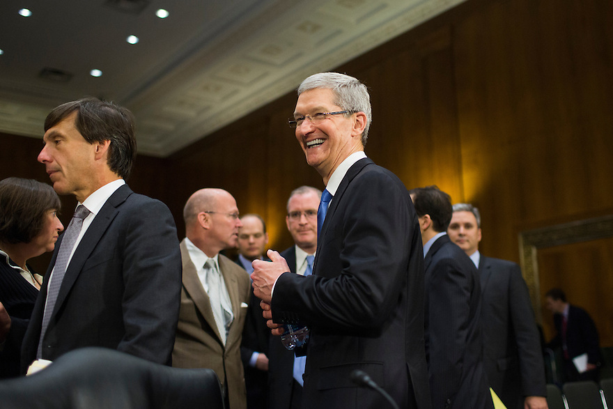 Apple CEO Tim Cook testifies at a Senate homeland security and governmental affairs investigations subcommittee hearing on offshore profit shifting and the U.S. tax code, on Capitol Hill in Washington. Apple Inc's chief executive officer defended the company's tax record during a Senate hearing where lawmakers said the maker of iPads, iPods and Mac computers kept billions of dollars in profits in Irish subsidiaries to avoid U.S. taxes.