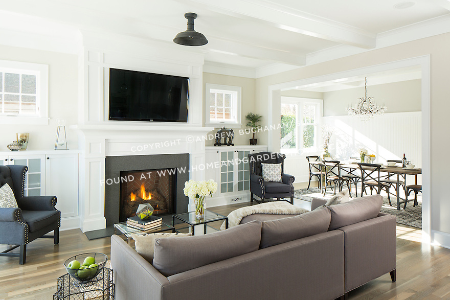 Fireplace, built-in bookshelves, and box beam ceiling in the living room of a traditional home. This image is available through an alternate architectural stock image agency, Collinstock located here: http://www.collinstock.com