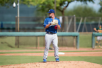 Los Angeles Dodgers relief pitcher Bryan Warzek (40) gets ready to deliver a pitch during an Instructional League game against the Oakland Athletics at Camelback Ranch on October 4, 2018 in Glendale, Arizona. (Zachary Lucy/Four Seam Images)
