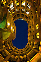 Upward perspective at dusk of the courtyard in the Gaudi House, an apprtment building in Barcelona, Spain.