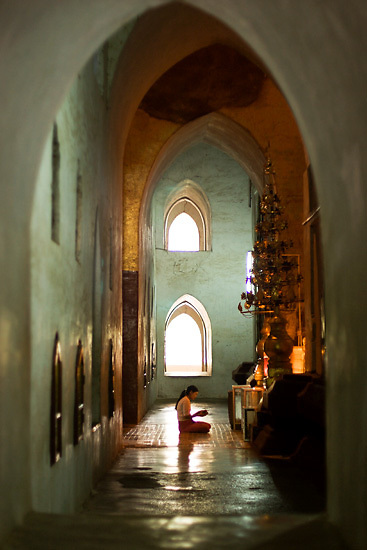 A Burmese woman prays at the Ananda Temple, Bagan, Burma, July 2006.  Photo: Ed Giles.