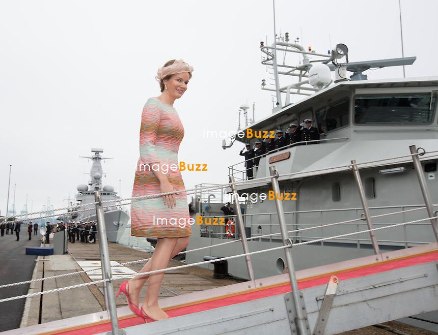 Queen Mathilde of Belgium attends the baptism of patrol ship P901 'Castor' by Queen Mathilde of Belgium on at the Zeebrugge marine base.<br /> Belgium, Zeebrugge, July 10, 2014.<br /> La Reine Mathilde de Belgique assiste au bapt&ecirc;me du patrouilleur P901 &ldquo;Castor&rdquo; au cours d&rsquo;une c&eacute;r&eacute;monie officielle &agrave; la base navale de Zeebruge. La Reine Mathilde est  &eacute;galement la marraine de ce navire. Il s&rsquo;agit du premier des deux patrouilleurs qui seront mis &agrave; l&rsquo;eau par la Composante Marine belge.<br /> Belgique, Zeebrugges, 10 juillet 2014.