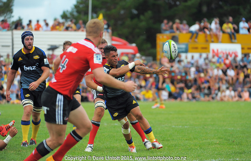 Frae Wilson gets his pass away in the tackle during the Super Rugby preseason match between the Hurricanes and Crusaders at Eketahuna, New Zealand on Saturday, 31 January 2015. Photo: Dave Lintott / lintottphoto.co.nz