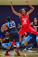 Washington, DC - August 31, 2018: Atlanta Dream guard Renee Montgomery (21) looks to pass the ball around Washington Mystics forward LaToya Sanders (30) during semi finals playoff game between Atlanta Dream and Wasington Mystics at the Charles Smith Center at George Washington University in Washington, DC. (Photo by Phil Peters/Media Images International)