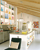 The ceilings throughout the house are constructed from simple unpainted plywood creating a rustic yet contemporary feel