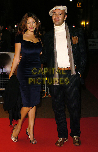 "KELLY BROOK & BILLY ZANE.Attends ""The Lives Of The Saints"" UK Film Premiere, held at the Odeon West End Cinema, London, England, October 20th 2006..full length blue dress black and cream lace peeptoe shoes cap hat scarf brown trainers belt couple.Ref: CAN.www.capitalpictures.com.sales@capitalpictures.com.©Can Nguyen/Capital Pictures"