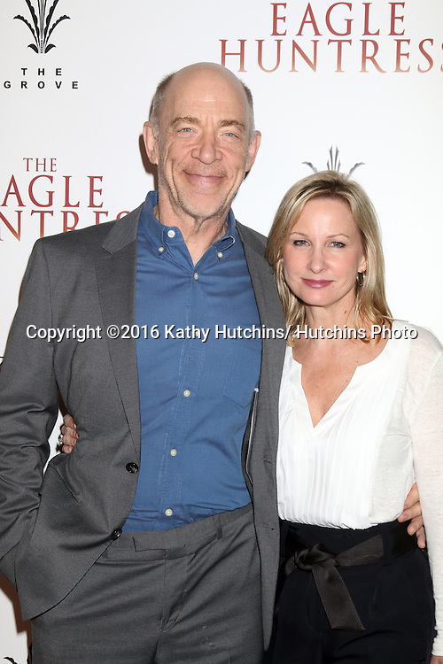 "LOS ANGELES - OCT 18:  J. K. Simmons, Michelle Schumacher at the ""The Eagle Huntress"" Premiere at the Pacific Theatres at The Grove on October 18, 2016 in Los Angeles, CA"