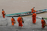 Some monks come back to their pagoda by boat, on the other side of the bank, Luang Prabang, Laos-2010