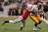 Iowa Hawkeyes tight end Jake Duzey (87) is tackled by Ohio State Buckeyes safety C.J. Barnett (4) during Saturday's game in Columbus, Ohio on Saturday, Oct. 19, 2013. (Jabin Botsford / The Columbus Dispatch)