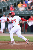 Peoria Chiefs shortstop Juan Herrera (12) at bat during a game against the Kane County Cougars on June 2, 2014 at Dozer Park in Peoria, Illinois.  Peoria defeated Kane County 5-3.  (Mike Janes/Four Seam Images)