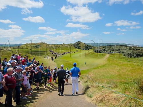 July 8th 2017, Portstewart Golf Club, Portstewart, Northern Ireland; Dubai Duty Free Irish Open Golf Championship, Day 3; Ryan Fox (NZL) on the left and John Rahm (ESP) make their way down the 1st fairway during the third round of the Dubai Duty Free Irish Open