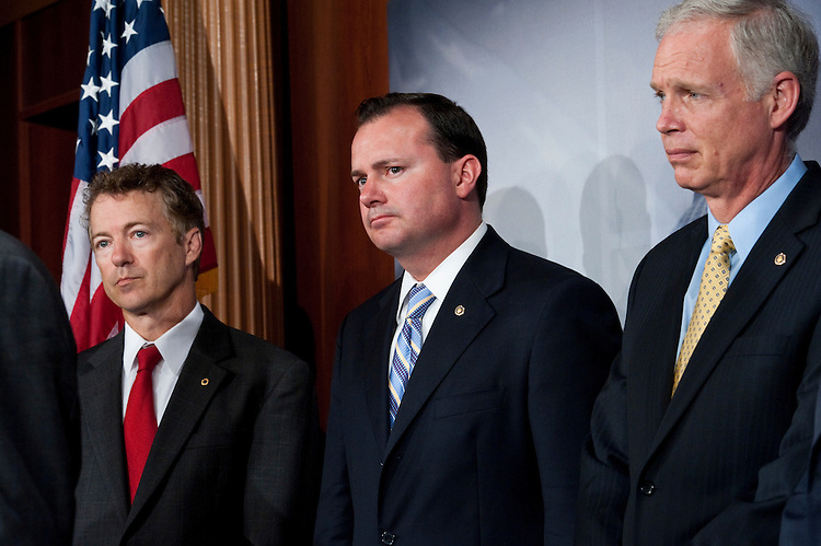 WASHINGTON, DC - July 07: Sen. Rand Paul, R-Ky., Sen. Mike Lee, R-Utah, and Sen. Ron Johnson, R-Wis., during a news conference on debt limit negotiations. (Photo by Scott J. Ferrell/Congressional Quarterly)