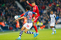 29th December 2019; The Hawthorns, West Bromwich, West Midlands, England; English Championship Football, West Bromwich Albion versus Middlesbrough; Ashley Fletcher of Middlesbrough wins the ball from Ahmed Hegazi of West Bromwich Albion - Strictly Editorial Use Only. No use with unauthorized audio, video, data, fixture lists, club/league logos or 'live' services. Online in-match use limited to 120 images, no video emulation. No use in betting, games or single club/league/player publications