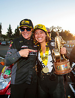 Nov 17, 2019; Pomona, CA, USA; NHRA pro stock motorcycle rider Jianna Salinas celebrates with teammate Karen Stoffer after winning the Auto Club Finals at Auto Club Raceway at Pomona. Mandatory Credit: Mark J. Rebilas-USA TODAY Sports