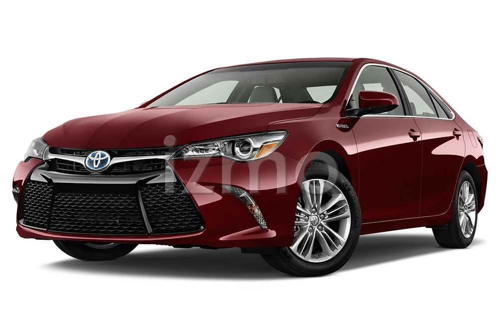 Stock pictures of low aggressive front three quarter view of a 2015 Toyota camry hybrid 4 Door Sedan