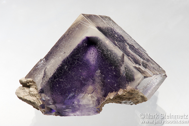 Fluorite, half-cube (about an inch on a side), clear with a deep purple phantom. Auglaize (StoneCo) Quarry, Junction, Ohio.