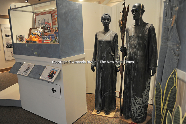 Statues of the American Gothic couple from a famous painting by Grant Wood are seen inside the American Gothic Museum beside the American Gothic house in Eldon, Iowaon April 23, 2009.  Eldon is located about one and a half hour southwest of Iowa City and has a population of 1,200.