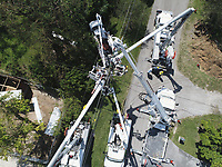 FPL linemen working at repairing damaged power lines in the Kendall area of South Miami-Dade county after Hurricane Irma Sept 12, 2017.