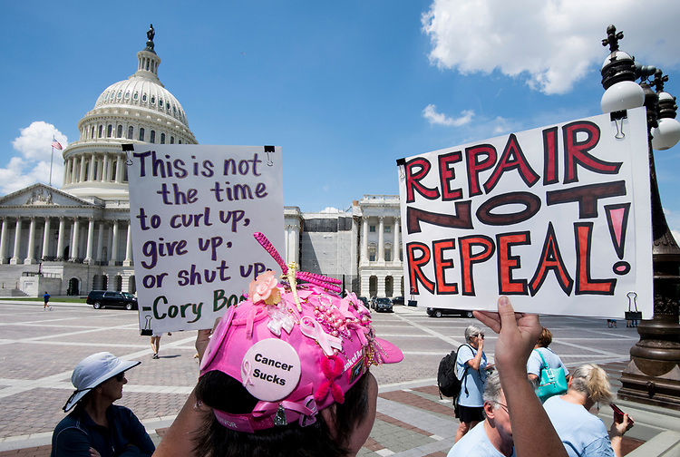UNITED STATES - JULY 26: A couple dozen members of the New Jersey Citizen Action group protest outside the Capitol as the Senate holds a second day of voting on health care legislation on Wednesday, July 26, 2017. (Photo By Bill Clark/CQ Roll Call)