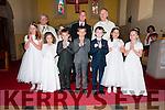 Pupils from Scoil Naomh Eirc Beth Ní Bhambaire, Aoife Nic Gearailt, Cathal Ó Groméil Fearghaile, Cian Mac Gearailt, Diarmuid Ó Ciardubhain, Fiadh Ní Chinnéide and Katie Nic Gearailt the day of their First Communion, here pictured with their muinteoir Padraig Ó Loingsigh, an tAthair Eoghan Ó Cadhla, an tAthair Tomas Ó hÍceadha and altar server, at Saipéal na Carraige, Baile na nGall, on Saturday.