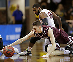 SIOUX FALLS, SD: MARCH 23: Alex Cook #11 from Bellarmine dives for the loose ball with Shammgod Wells #55 from Fairmont State during the Men's Division II Basketball Championship Tournament on March 23, 2017 at the Sanford Pentagon in Sioux Falls, SD. (Photo by Dick Carlson/Inertia)