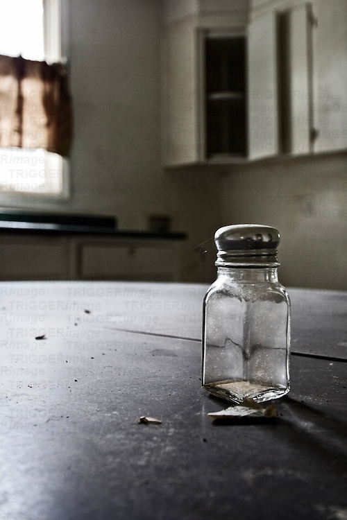 Old salt shaker in abandoned warehouse