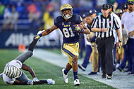 Annapolis, MD - September 8, 2018: Navy Midshipmen wide receiver Collins Woods III (81) avoids a tackle by Memphis Tigers defensive back Tito Windham (24) during game between Memphis and Navy at  Navy-Marine Corps Memorial Stadium in Annapolis, MD. (Photo by Phillip Peters/Media Images International)