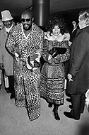 Manhattan, New York City, NY. March 8th, 1971. Musician Isaac Hayes attending Muhammad Ali and Joe Frazier fight at Madison Square Garden. Billed as the &lsquo;Fight of the Century&rsquo; African-American boxing fans and dandies attended wearing the most glam-fashions of the day. Furs, minis and thigh-high platform boots were all the rage.  <br />