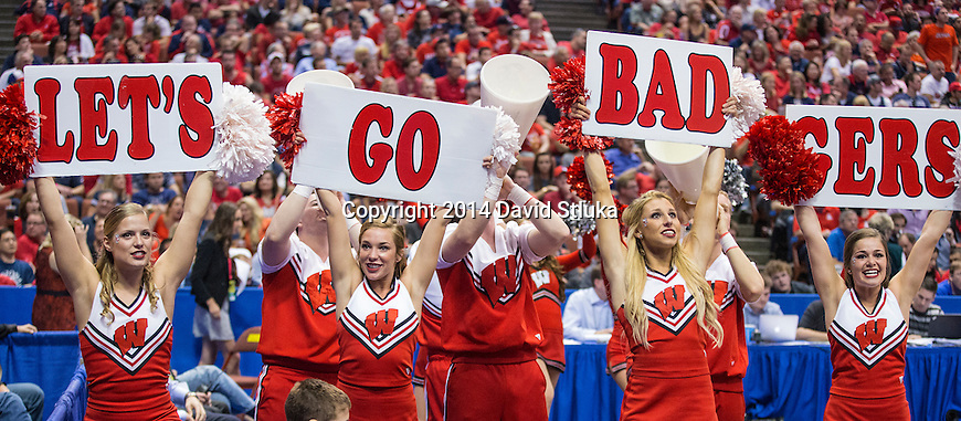 Wisconsin Badgers cheerleaders hold up signs during the Western Regional Final NCAA college basketball tournament game against the Arizona Wildcats Saturday, March 29, 2014 in Anaheim, California. The Badgers won 64-63 (OT). (Photo by David Stluka)