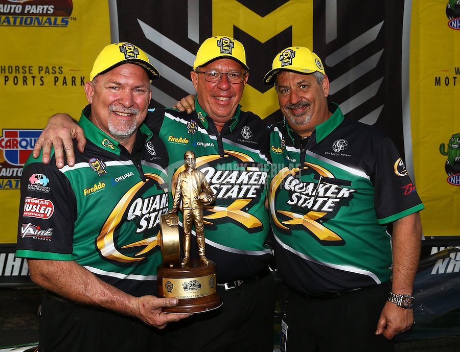 Feb 28, 2016; Chandler, AZ, USA; Co crew chiefs Mike Guger (center) and Joe Barlam (right) for NHRA top fuel driver Leah Pritchett (not pictured) celebrate after winning the Carquest Nationals at Wild Horse Pass Motorsports Park. Mandatory Credit: Mark J. Rebilas-