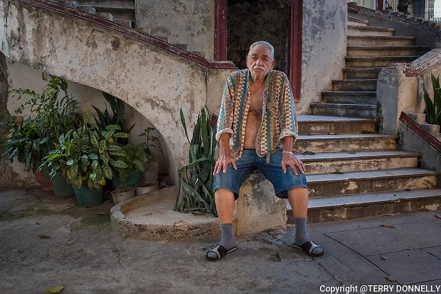 Havana, Cuba:<br /> Vedado neighborhood, a gentlemen rests on his front steps