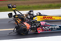 Mar 17, 2019; Gainesville, FL, USA; NHRA top fuel driver Richie Crampton (far) defeats Leah Pritchett during the Gatornationals at Gainesville Raceway. Mandatory Credit: Mark J. Rebilas-USA TODAY Sports